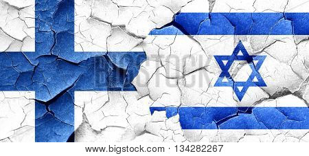 finland flag with Israel flag on a grunge cracked wall