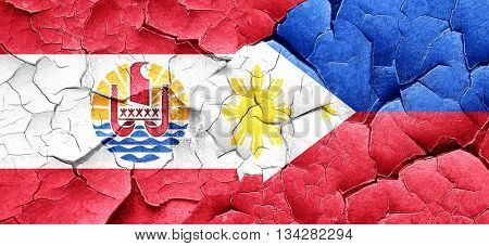 french polynesia flag with Philippines flag on a grunge cracked