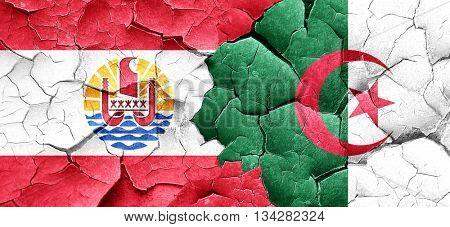 french polynesia flag with Algeria flag on a grunge cracked wall