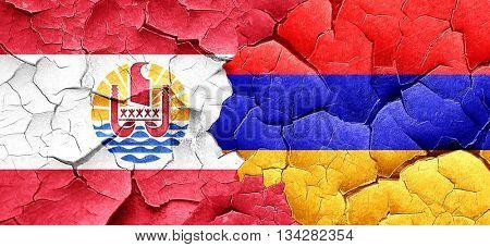 french polynesia flag with Armenia flag on a grunge cracked wall