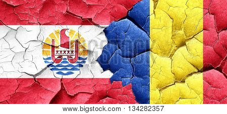 french polynesia flag with Romania flag on a grunge cracked wall
