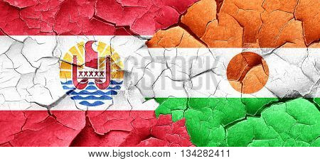french polynesia flag with Niger flag on a grunge cracked wall