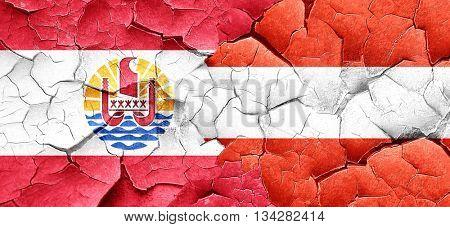 french polynesia flag with Austria flag on a grunge cracked wall