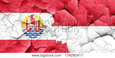 french polynesia flag with Indonesia flag on a grunge cracked wa