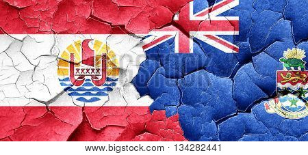french polynesia flag with Cayman islands flag on a grunge crack