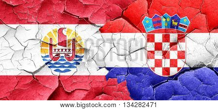 french polynesia flag with Croatia flag on a grunge cracked wall