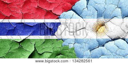 Gambia flag with Argentine flag on a grunge cracked wall