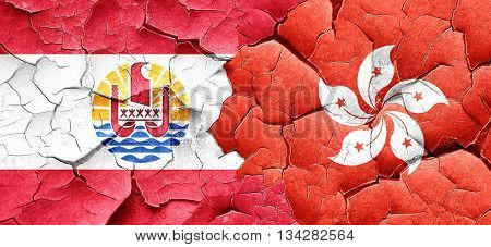 french polynesia flag with Hong Kong flag on a grunge cracked wa