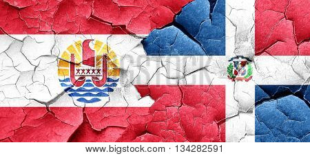 french polynesia flag with Dominican Republic flag on a grunge c