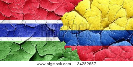 Gambia flag with Colombia flag on a grunge cracked wall