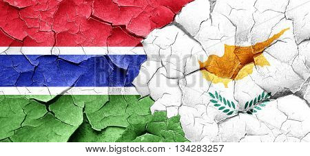 Gambia flag with Cyprus flag on a grunge cracked wall