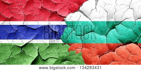 Gambia flag with Bulgaria flag on a grunge cracked wall