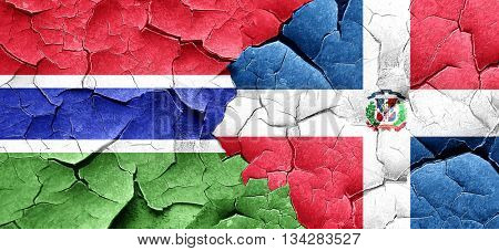 Gambia flag with Dominican Republic flag on a grunge cracked wal
