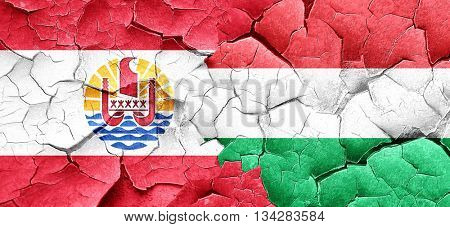 french polynesia flag with Hungary flag on a grunge cracked wall