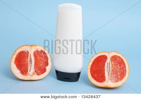 cosmetics bottle with grapefruits