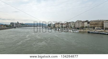 Budapest Hungary - April 10 2016: River Danube in Budapest Hungary with riverbanks and ships