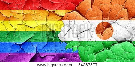 Gay pride flag with Niger flag on a grunge cracked wall