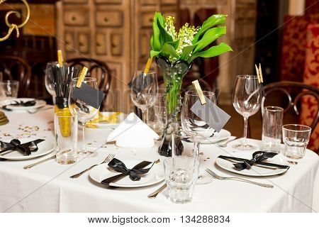 Birthday Guests Table Setting With Fresh Flowers In Black And Gold Style, Indoor