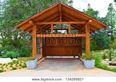 Outdoor wooden shed surrounded by a garden taken in a residential backyard