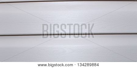 Background of Installed on the facade of house panels beige vinyl siding