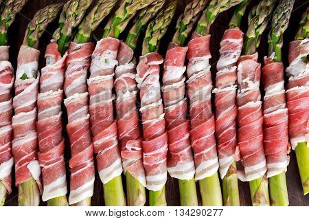 Fresh Organic raw Bacon Wrapped Asparagus. view from top. background.