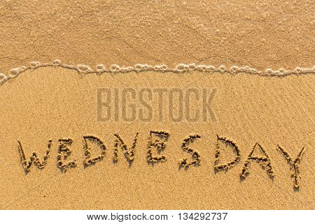 Wednesday - drawn on the sand beach with the soft wave.