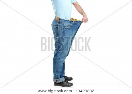 Male Showing His Lost Weight By Putting On Jeans