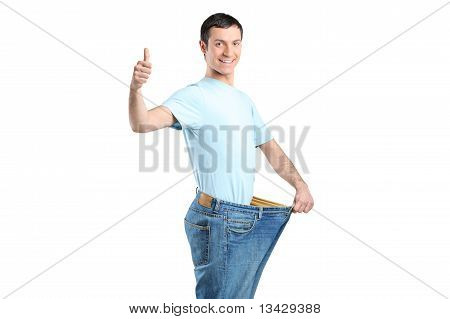 Portrait Of A Weight Loss Male With Thumb Up