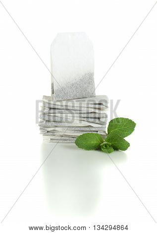 Tea with mint leaves - teabags on white background