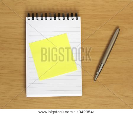 Blank Postit On Notebook With Pen