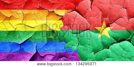 Gay pride flag with Burkina Faso flag on a grunge cracked wall