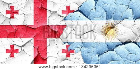 Georgia flag with Argentine flag on a grunge cracked wall