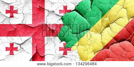 Georgia flag with congo flag on a grunge cracked wall