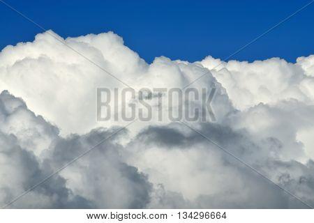 White Cumulus clouds against blue sky closeup