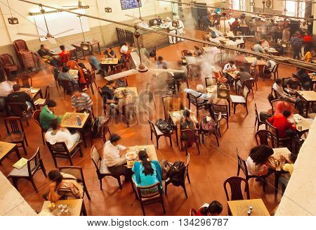 KOLKATA, INDIA - JAN 15, 2016: Interior of old cafe near the indian university with relaxing people on January 15, 2016. Kolkata's literacy rate of 87.14 perc. exceeds the all-India average of 74 perc.