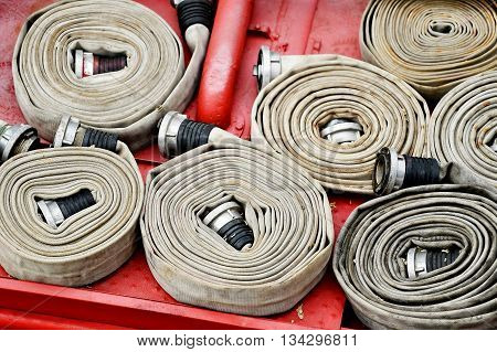 Detail with heavy duty water hoses on top of a firefighter vehicle