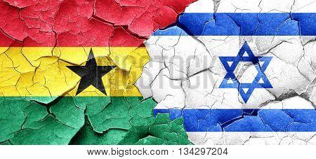 Ghana flag with Israel flag on a grunge cracked wall