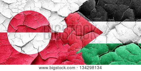 greenland flag with Palestine flag on a grunge cracked wall