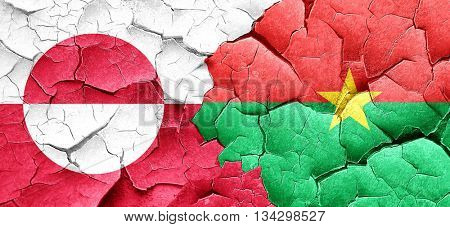 greenland flag with Burkina Faso flag on a grunge cracked wall