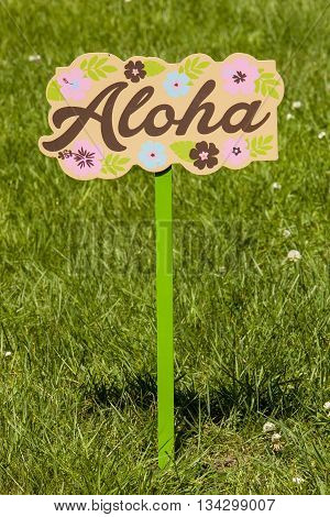 A hawaiian themed Aloha lawn sign for a tropical party