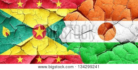 Grenada flag with Niger flag on a grunge cracked wall