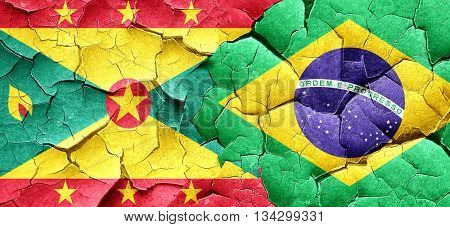 Grenada flag with Brazil flag on a grunge cracked wall