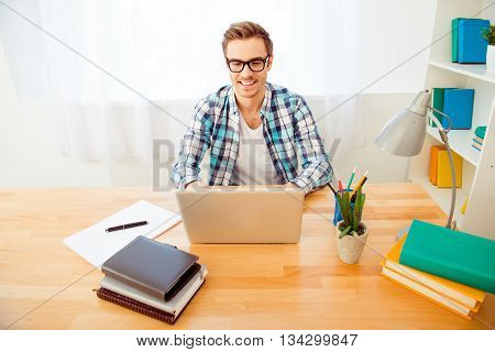 Cheerful Guy In Glasses Writing His New Book