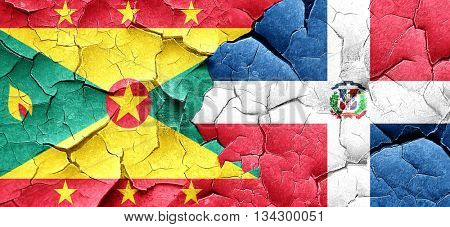 Grenada flag with Dominican Republic flag on a grunge cracked wa