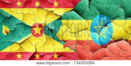 Grenada flag with Ethiopia flag on a grunge cracked wall