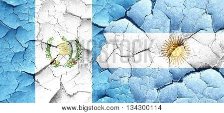 guatemala flag with Argentine flag on a grunge cracked wall