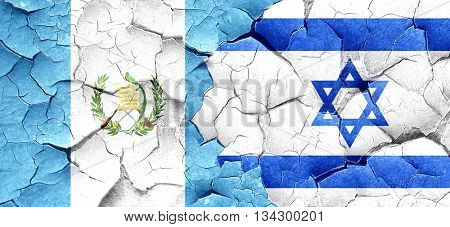guatemala flag with Israel flag on a grunge cracked wall