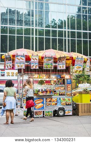 NEW YORK CITY, USA - May 28, 2016: Famous New York food cart that can be found on most major pedestrian routes in the midtown area of manhattan.