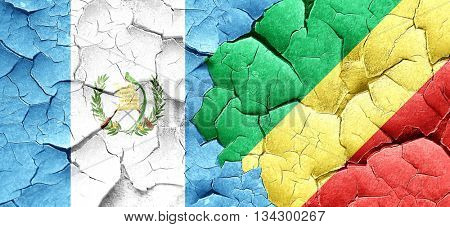 guatemala flag with congo flag on a grunge cracked wall
