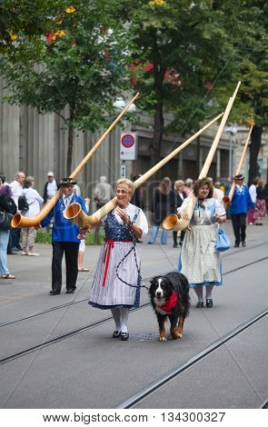 ZURICH - AUGUST 1: Swiss National Day parade on August 1, 2009 in Zurich, Switzerland. Musicians in a historical costumes.